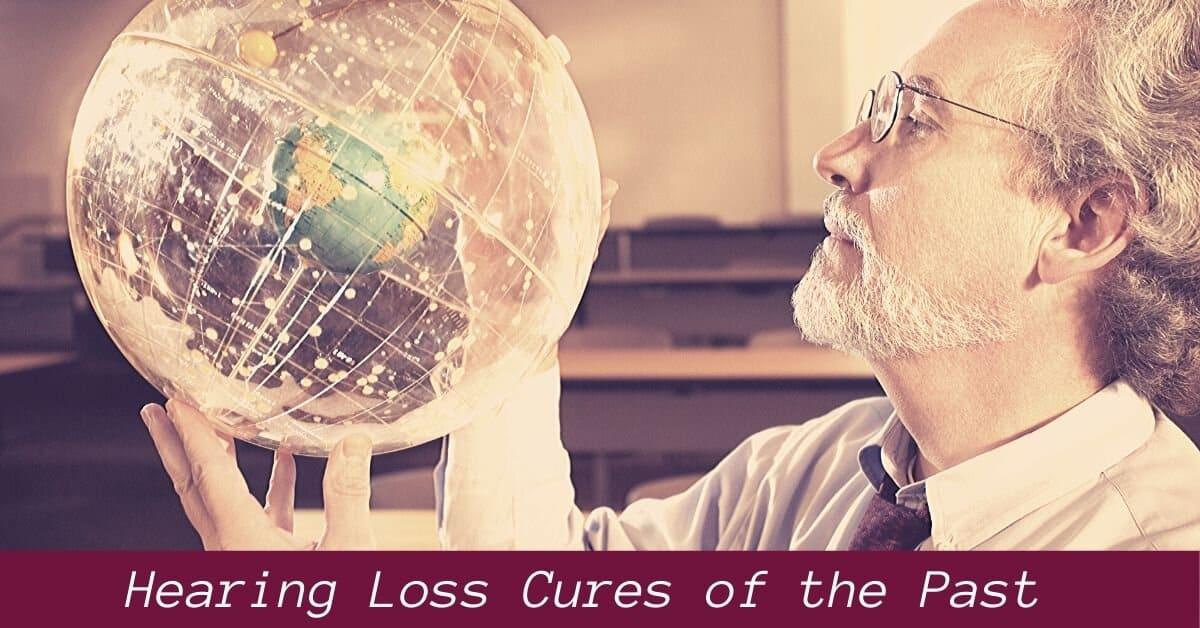 man examines globe model